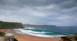 View of the sandy beach in cloudy foggy day Stock Photo
