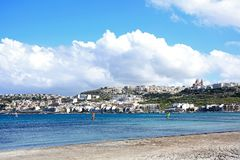 Melleiha beach and town, Malta. View of the sandy beach with town buildings across the bay, Mellieha, Malta, Europe Royalty Free Stock Image