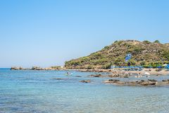 View on a beach with umbrellas in the Greece royalty free stock image