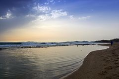 View of a sandy beach in a windy weather. Winter in Attica - Greece stock photography