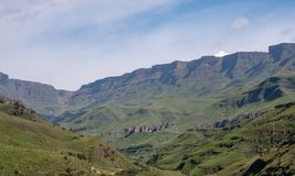 View of the Sani Pass, dirt rural road though the mountains which connects South Africa and Lesotho. The Sani Pass in the Drakensberg mountains, very high royalty free stock photos