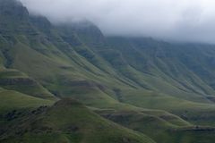 View from the Sani Pass, dirt rural road though the mountains which connects South Africa and Lesotho. The Sani Pass in the Drakensberg mountains, very high royalty free stock image