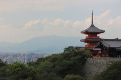 View of Sanjūnodō pagoda highest pagoda in Japan with 31 m. high with Kyoto city on background, Kiyomizu-dera temple, Kyoto. View of Sanjūnodō pagoda Royalty Free Stock Photos