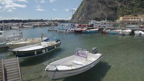 View of Sant Angelo port near Ischia village, boats floating on water, Italy stock video footage