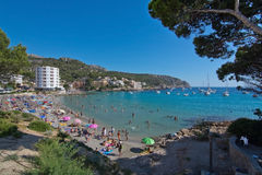 View in Sant Elm. SANT ELM, BALEARIC ISLANDS, SPAIN - JULY 10, 2016: View over beach with sunbathers in Sant Elm on a sunny summer day on July 10, 2016 in Palma Royalty Free Stock Photos