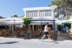 View in Sant Elm. SANT ELM, BALEARIC ISLANDS, SPAIN - JULY 10, 2016: Young man outside restaurant in Sant Elm on a sunny summer day on July 10, 2016 in Palma de Royalty Free Stock Photo