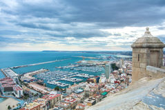 A view from Santa Barbara Castle at the hill in the center of Alicante to a port of the city with a plenty of yachts Stock Photography