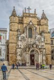 View of the Santa Cruz Monastery front facade, romanesque and gothic style, with tourists on street , a National Monument in royalty free stock images