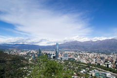 A view of Santiago city in chile. A cityscape of Santiago Chile in latinamerica with a blue cloudy sky and mountains royalty free stock images