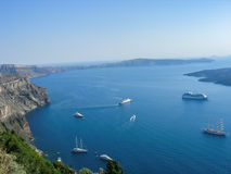 The view from Santorini. The view from the cliffs of Santorini, Greece with several ships on the water royalty free stock photography