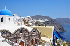 The view from Santorini Island, Fira town from above. Greece. On Santorini Island Fira is typical blue domes lined up on the volcano side in Oia town Royalty Free Stock Photography