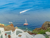 View of Santorini sea with many cruise ships Stock Image