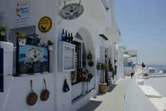 Street view of Santorini town with tourist shooting pictures stock images