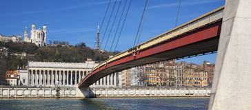 View of Saone river at Lyon with red footbridge Royalty Free Stock Images