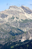 View of the Sassolungo mountain, Italian Dolomites. The village of Campitello is massively overlooked by the majestic Sassolungo and Col Rodella, where it is royalty free stock photos