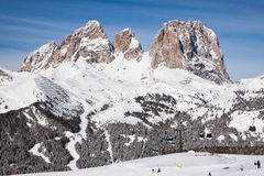 View of the Sassolungo (Langkofel) Group of the Italian Dolomites in Winter from the Belvedere Ski Area in Canazei. Royalty Free Stock Images