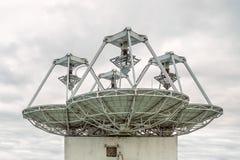Satellite antennas looking into space. View of satellite antennas looking into space royalty free stock photo