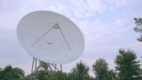 Full shot of the satellite array with trees. View of the satellite array with trees stock footage