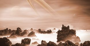 View at Saturn from the moon Titan, alien landscape with ocean and strange rock formations Royalty Free Stock Images