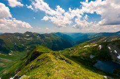 View from Saua Vaiuga in to the Valley of Fagaras. Beautiful summer landscape of Southern Carpathian mountains, Romania Royalty Free Stock Photography