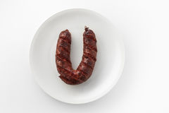 View of sausage on a white plate Stock Photos