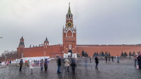 View of The Saviour Spasskaya Tower timelapse hyperlapse and Kremlin walls of Moscow Kremlin, Russia at day in winter. View from Red Square stock footage