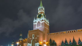 View of The Saviour Spasskaya Tower timelapse hyperlapse and Kremlin walls of Moscow Kremlin, Russia at night in winter. View from Red Square stock footage