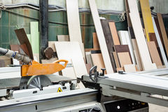 View on saw machine at carpenters workshop. Royalty Free Stock Photography