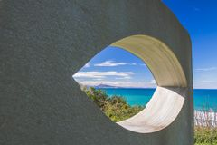View on scenic beautiful atlantic coastline mountain jaizkibel through eye shape hole in the wall. France Stock Image