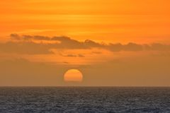 View on scenic orange sunset at sea stock photography
