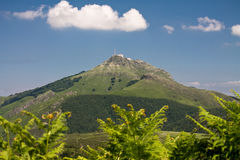 View on scenic peak mountain la rhune in colorful blue sky, symbol of basque country, france. Hiking to beautiful mountain la rhune in scenic blue sky with Stock Photos