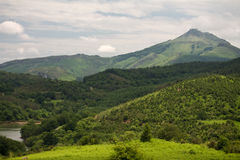 View on scenic peak mountain la rhune in colorful cloudy sky, symbol of basque country, france. Hiking to beautiful mountain la rhune in scenic cloudy sky with Stock Photos