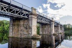 A view of scenic railway bridge crossing river Dee near Duthie park, Aberdeen. Scotland stock photo