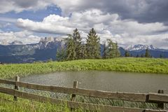 View of the Schlern and the rose garden group. View from the Ritten on the Schlern mountains and the rose garden group in South Tyrol stock photos