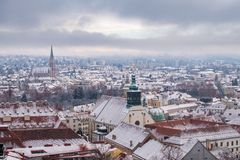 View from Schlossberg in Graz to Herz-Jesu-Church in winter. View from Schlossberg in Graz to Herz-Jesu-Church with some snow in winter stock photography