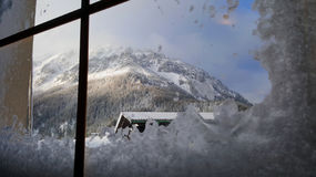 View of the Schneeberg mountain through an icy window Royalty Free Stock Photography