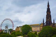 View of Scott Monument, Princes Street Gardens and Edinburgh Fes. Tival Wheel Ferris Wheel, Big Wheel in Edinburgh, Scotland stock photo