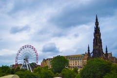 View of Scott Monument, Princes Street Gardens and Edinburgh Fes. Tival Wheel Ferris Wheel, Big Wheel in Edinburgh, Scotland royalty free stock photo