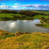 View of the Scottish lowlands. Rolling hills and loch in Bonny Scotland Royalty Free Stock Image