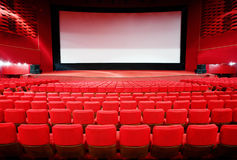 View on screen through rows of chairs in cinema Royalty Free Stock Images