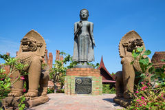 View of a sculpture of standing Buddha, on a sunny day. Wat Thammikarat in the historic town Royalty Free Stock Images