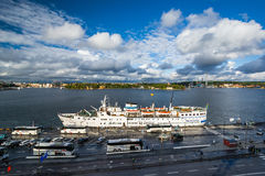 View of Söder Mälarstrand and a cruise ship anchored in Söder Stock Photo