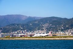 View from the sea of ​​the mountains, the city, the airport and the port of the city of Genoa, Italy. stock images