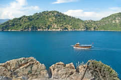 View of sea bay with tourist boat from cliff Stock Image