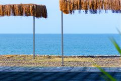 View of the sea beach with thatched canopies. stock photo