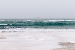 View of sea and beach in winter during snowfall and wind, the se Royalty Free Stock Images