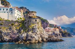 Wonderful Italy. The small haven of Amalfi village with a turquoise sea and colorful houses on the slopes of the coast. View from the sea on the beautiful stock photos