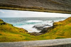 View of the sea beyond a fence at the Nobbies in Australia Royalty Free Stock Images
