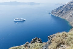 View of the sea and the boat with steep coast of the island of S. Antorini, Greece Stock Photography