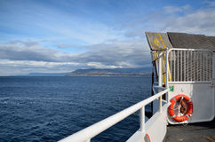 View of the sea from the bow of a ferry boat Stock Images